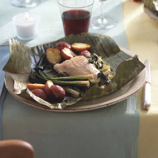 Fish Wrapped in Banana Leaves with Chile Rajas and Crema.