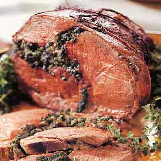 Leg of Lamb Stuffed with Wild Mushrooms and Greens.