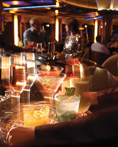 Venture into the Yacht Club aboard Queen Elizabeth for a quiet respite during the day and evening entertainment and dancing on its compass-shaped dance floor.