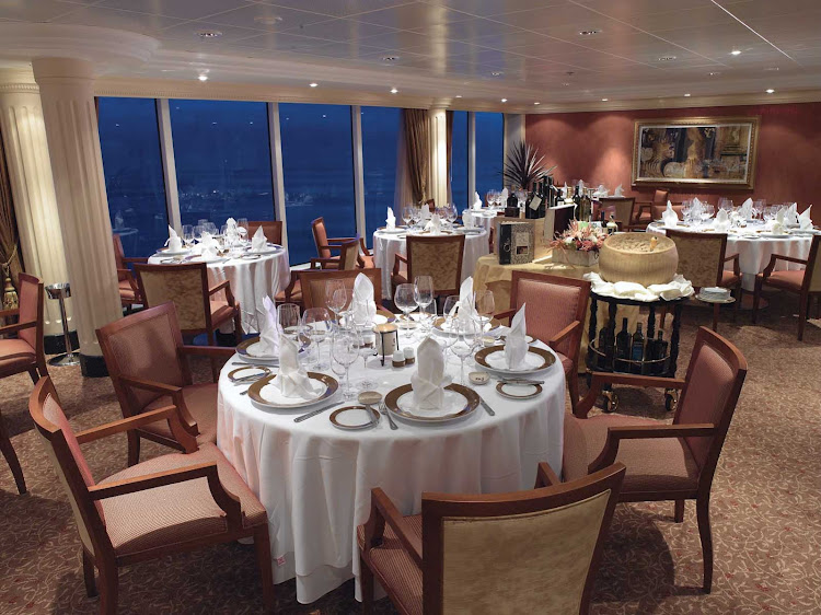 The expansive views and opulent dining room of Oceania Insignia's Toscana restaurant is a great setting to experience authentic Tuscan cuisine.