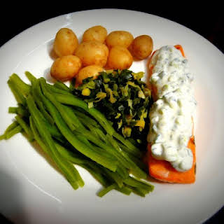 Baked Salmon with Cucumber Dill Sauce.