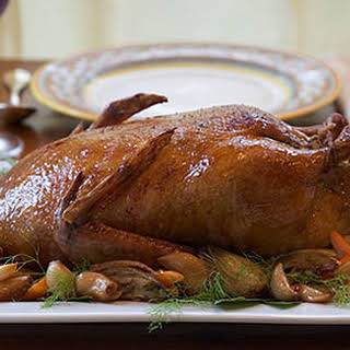 Slow-Roasted Duck with Olive Gravy and Garlic-Fennel Confit.