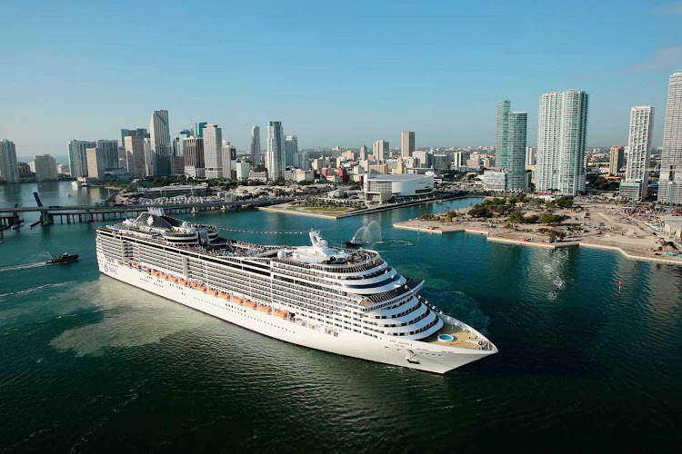 Enjoy a memorable vacation aboard the impressive MSC Divina, shown here against the Miami skyline.