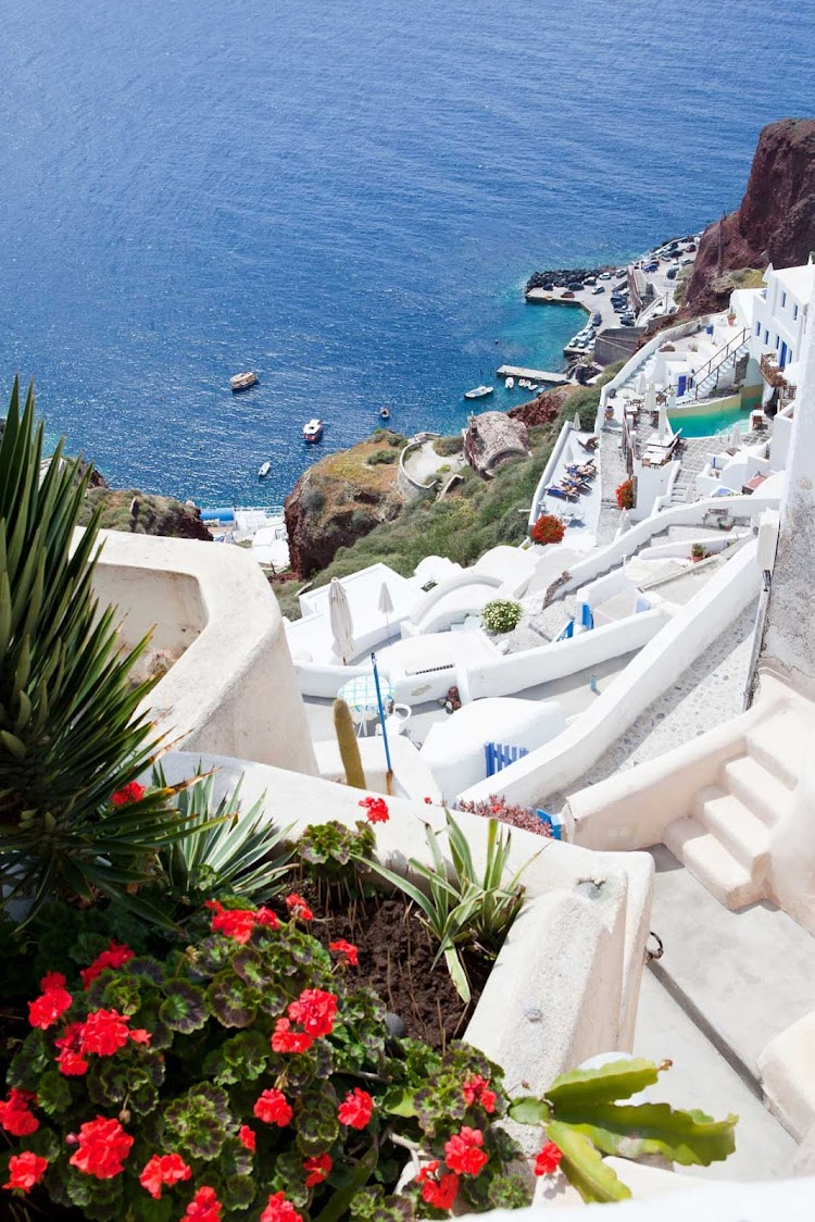 Perch atop a cliff in Fira, the capital of Santorini, and look down at sugar cube houses and a labyrinthe of walkways during your Mediterranean cruise aboard Seven Seas Mariner.