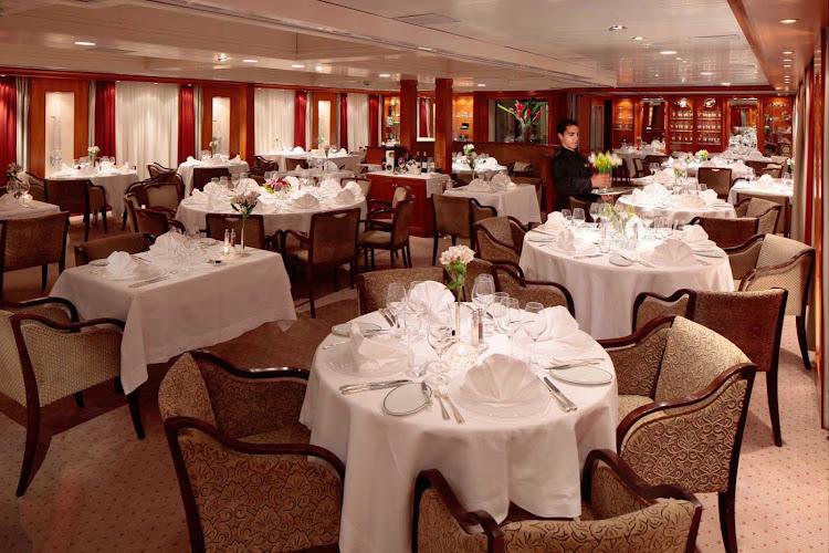 Enjoy elegant dining in the Dining Salon on a SeaDream cruise.