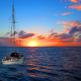 sunset in the bahamas by Jay Anderson - Transportation Boats ( water, sunset, sea, sail, boat, sun,  )