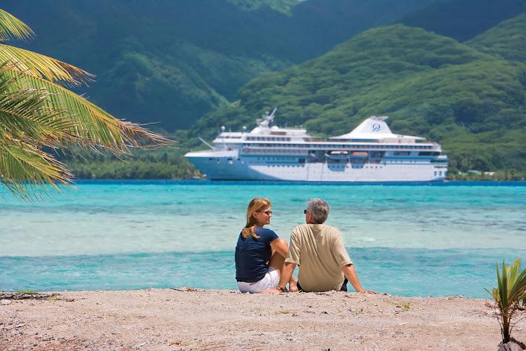 A couple relaxes during a shore excursion on a Paul Gauguin cruise.