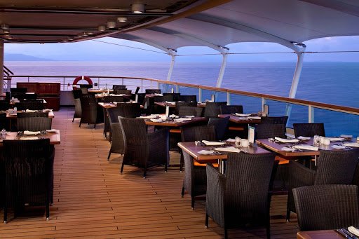 Watch the sunset on the outside deck by dining at the Colonnade aboard Seabourn Sojourn.