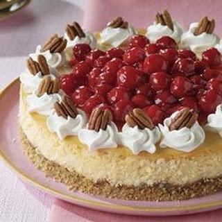 White Chocolate Cherry Pecan Cheesecake.