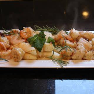 Shrimp and Calamari with Mint Pesto on Sprigs of Rosemary..