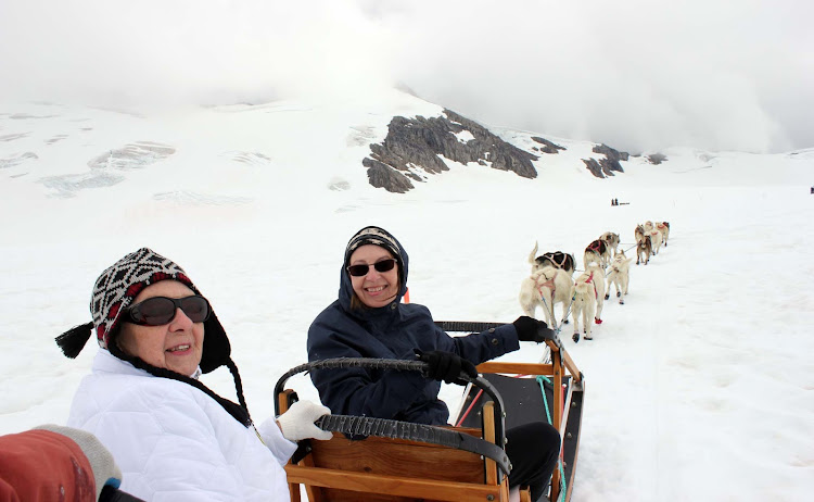 "Colleen Hilker: ""That's me and my mom on our first sled dog excursion. We started out with a helicopter ride to see the sights around Juneau."""