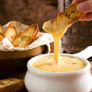 Gouda Cheese Fondue with Herbed Crostini.