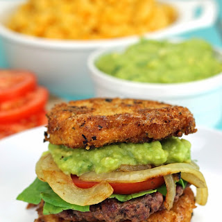 Mac and Cheese Burgers with Guacamole and Grilled Onions.