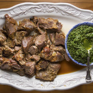 Slow-Cooked Lamb Shoulder with Pounded Herbs and Green Garlic.