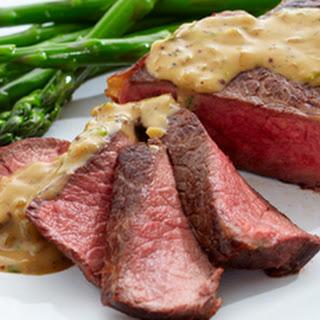 Pan Seared Striploin Steak with Whisky Peppercorn Sauce