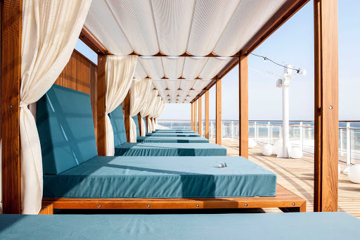 Europa-2-daybeds - Want to relax in style while taking in great sea views? Head to deck 10 of Europa 2 and lounge on one of the comfy daybeds.