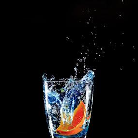 orange  by Jurugambar Perkahwinan - Food & Drink Fruits & Vegetables ( water, orange, reflection, splash, blue )