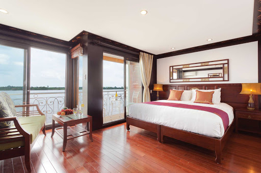AmaLotus-twin-balcony-jr - A twin balcony junior suite aboard AmaLotus with a décor that combines colonial elegance with regional Khmer accents. Suites feature large sitting areas, air-conditioning, mini-bar, safety deposit box and a bathtub.