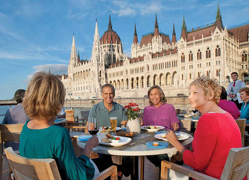 Viking-Longship-Aquavit-dining-in-Budapest - Have lunch on the deck of your Viking Longship while taking in the impressive architecture of the Parliament building in Budapest and other storied cities along the Danube.