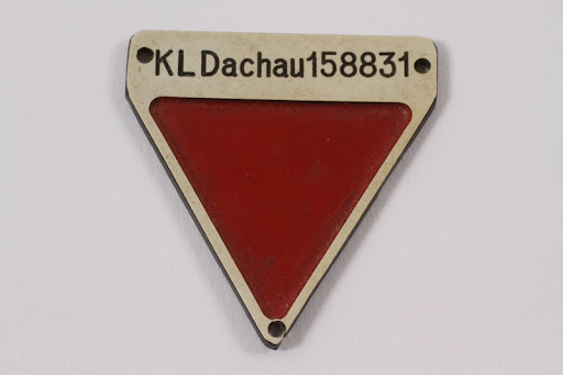 Commemorative red inverted triangle Dachau badge 158831 owned by a former German Jewish inmate