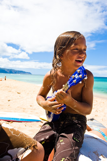 boy-plays-ukulele - A young local boy plays the ukulele in Hawaii.