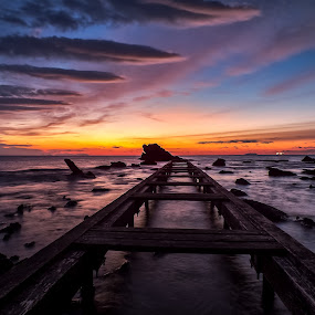 Pier At Sunset by Alessandro Genero - Buildings & Architecture Bridges & Suspended Structures ( water, clouds, tuscany, relax, waves, sea, relaxing, waterscapes, boat, tranquil, sky, le, sunset, pier, tranquility, livorno, landscapes, italy,  )