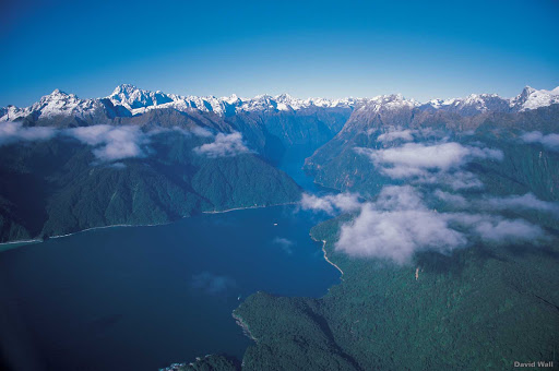 entrance_to_Milford_Sound - Fiordland's Milford Sound was carved by glaciers during the ice age. The immense beauty of the area can be appreciated from air or sea — on a cruise ship.