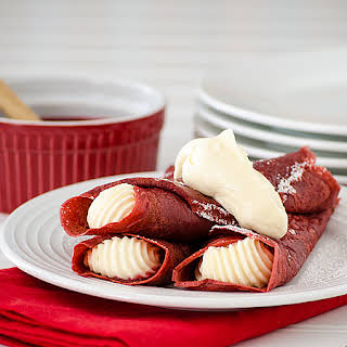 Red Velvet Crepes with Cheesecake Mousse and Raspberry Sauce.
