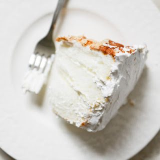 Angel Food Layer Cake with Coconut Whipped Cream and Grapefruit Syrup.