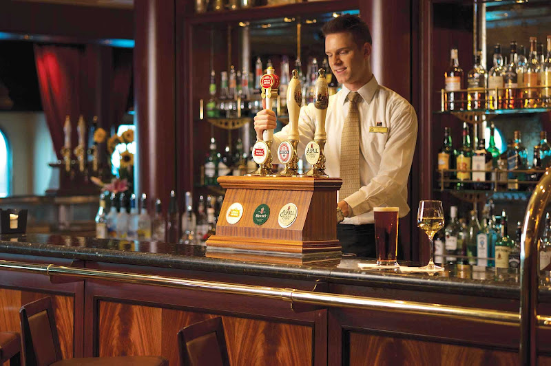 Choose from a wide assortment of brews on tap at the Golden Lion Pub aboard Queen Mary 2.