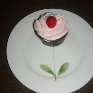 Chocolate Cupcakes with Raspberry Filling and Raspberry Butter Cream Frosting.