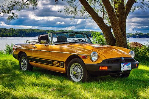 MGB at Okoboji by Rachaelle Larsen - Transportation Automobiles ( 1979 mgb, sports car, lake, yellow, convertible )
