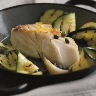 Wild Alaskan halibut with lemon, capers and char-grilled courgettes.