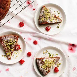 Gluten-Free Honey Almond Cake with Raspberries, Orange and Pistachios