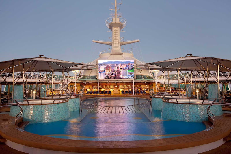 Watch a movie from the pool on Rhapsody of the Seas' outdoor movie screen.