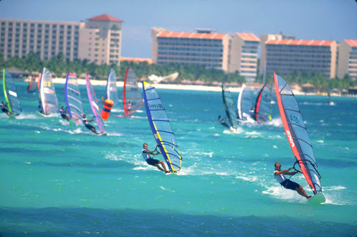 windsurfing-crowd-Aruba - A squadron of windsurfers on Aruba.