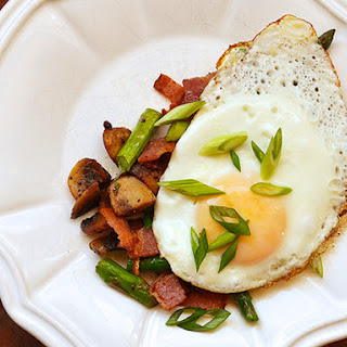 Mushrooms, Bacon, and Asparagus Topped With Eggs.