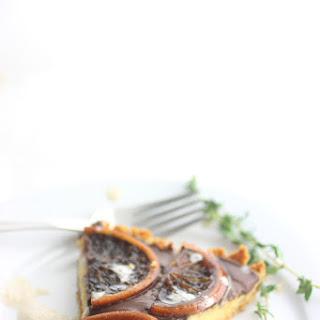 Orange Curd Tart with Dark Chocolate Ganache and Thyme Infused Cream.