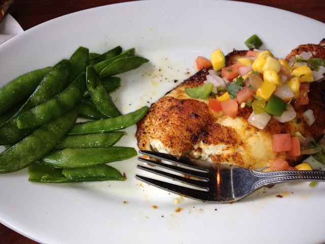 Gluten free Tilapa with mango salsa and sugar snap peas. Delicious!