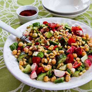 Fattoush-Inspired Chopped Salad with Tahini-Buttermilk Dressing, Chickpeas, Sumac, and Pine Nuts.