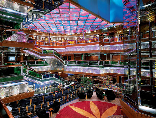 Carnival-Glory-Colors-Lobby - Stroll through a multi-deck kaleidoscope in Carnival Glory's Colors Lobby.