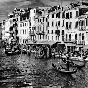 Venetian Cityscape by Dobrinovphotography Dobrinov - Black & White Buildings & Architecture ( reflection, europe, monochrome, famous place, people in the background, cityscape, architecture, travel, city, flowing water, arch bridge, veneto, long exposure, travel destinations, italy, public building, travel locations, water, western europe, rialto bridge, grand canal, blurred motion, city life, tourism, italian culture, architecture and buildings, urban scene, landmark, building exterior, southern europe, dawn, facade, venice - italy, covered bridge, horizontal, residential structure, bridge, built structure, panoramic,  )