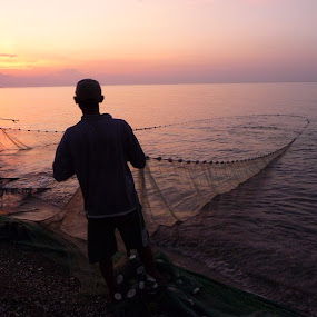 Fishing by Kirsten Gamby - People Professional People ( fishing at kalibukbuk bali, fishing at sunset, hauling in fishing net, fisherman, man fishing with net,  )
