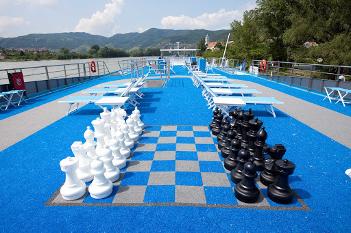 AmaDolce-Sundeck-Chess - Let the games begin! Play a game of chess or relax on the sun lounges on the top deck of AmaDolce while exploring the waterways of Europe.