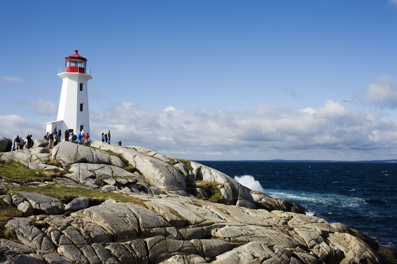 Hurtigruten guests pay a shore excursion to Peggy's Cove Lighthouse on the eastern shore of St. Margarets Bay in Halifax, Nova Scotia. The lighthouse dates to 1868.