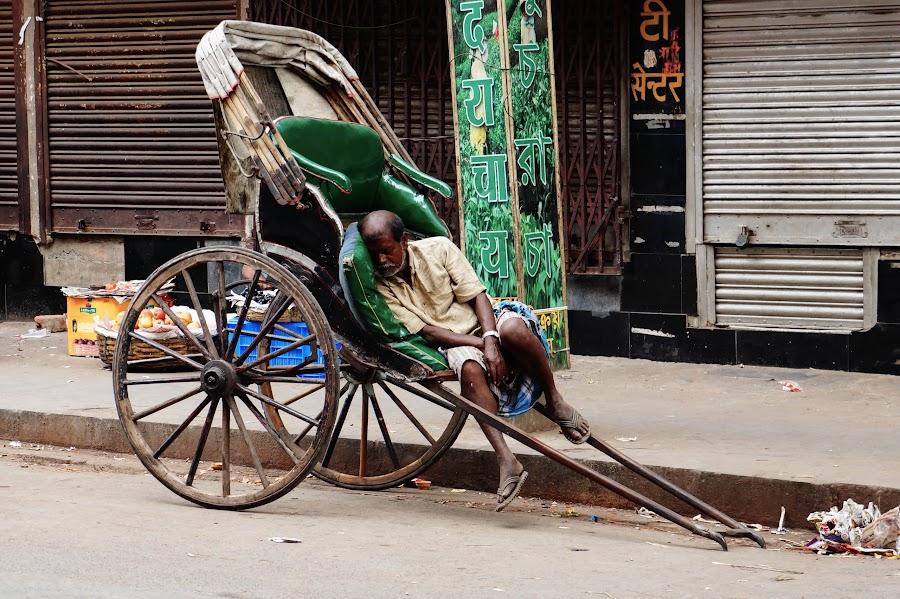 Nap time by Caesar Jees - People Street & Candids ( transport, kolkata, street, rickshaw-puller, rickshaw, people )