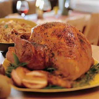 Spice-Rubbed Smoked Turkey with Roasted-Pear Stuffing and Cranberry Syrup.