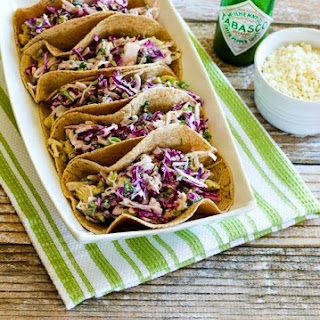 Low-Carb Slow Cooker Green Chile Chicken Tacos with Poblano-Cabbage Slaw.