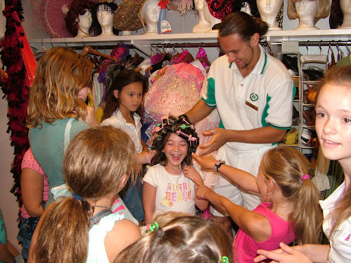 Junior-Cruisers-Dressing-Up-with-Junior-Activities-Director - Kids will have a blast dressing up with other Junior Cruisers activities aboard a Crystal cruise.
