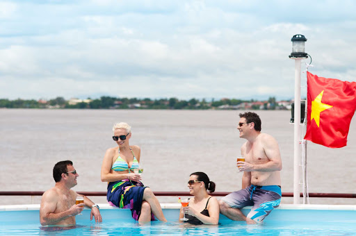 AmaLotus-Sundeck-Pool - Spend time with new friends and a cocktail while poolside on the AmaLotus sundeck as you sail the Mekong River in Cambodia and Vietnam.